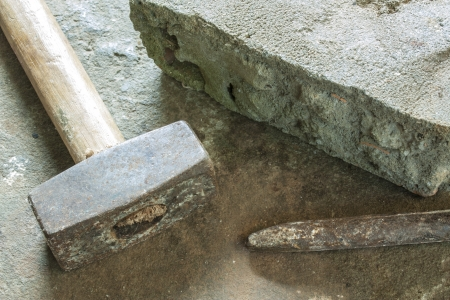 stone work: bricklayer tools  chisel and hammer  ,construction background
