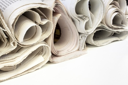 Various newspapers over white background photo