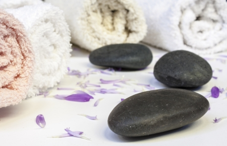 line of towels with petals and stones photo