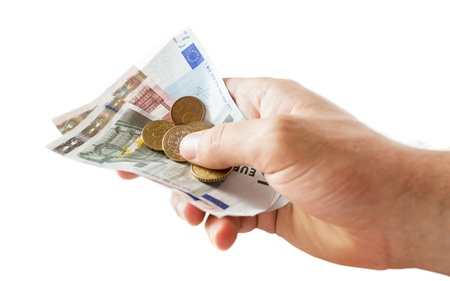 holding money in the hand, isolated photo