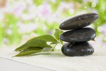 stones with towel and leaf photo