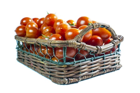 cherry tomatoes basket isolated Stock Photo - 15735657