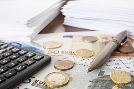 Money, bills and calculator,accounting Stock Photo - 16030146