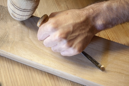 gouge: gouge wood chisel carpenter tool working wooden background