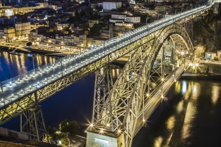 Dom Luis bridge over Douro river at night in Porto Portugal Imagens
