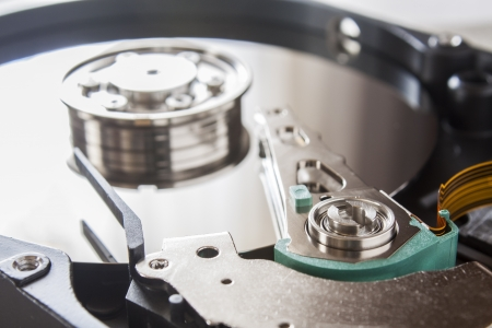 hdd: Close up of opened hard disk drive Stock Photo