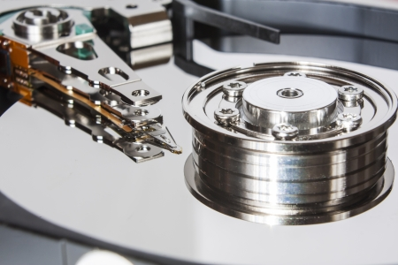 hard disk drive: Close up of opened hard disk drive Stock Photo