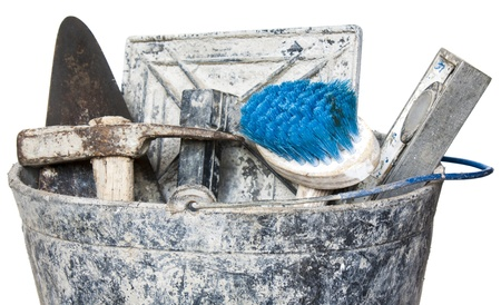 Construction masonry cement mortar tools on bucket,isolated