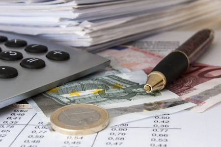 Money, bills and calculator,accounting,shallow  depth of field Stock Photo - 16839122