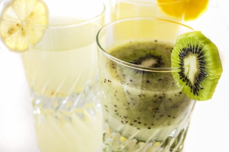 fresh kiwi juice isolated on white close up photo
