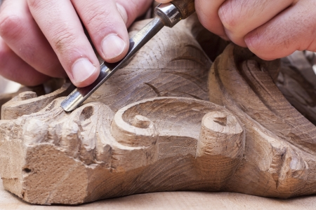 craftsman carving with a gouge
