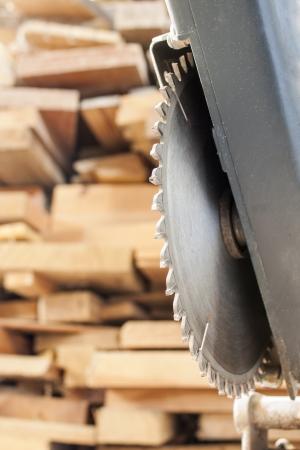 craftsmanship: Compound Mitre Saw cutting planks wooden background