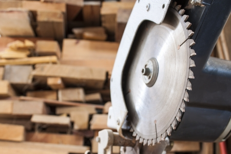 compound: Compound Mitre Saw cutting planks wooden background
