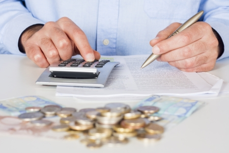 Business men working with documents and calculator  in the office Stock Photo - 16941829