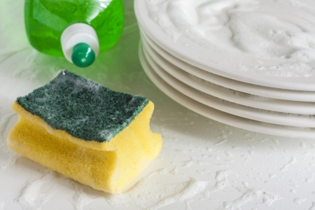 Washing glasses and plates with detergent and water Stock Photo - 16941825