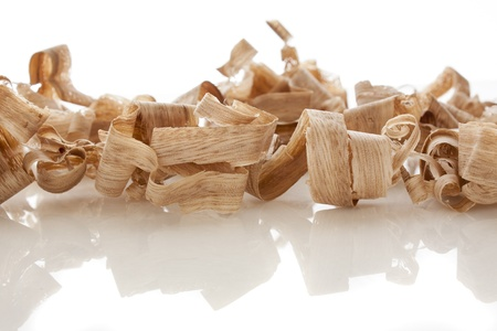 wood shavings over white background Imagens