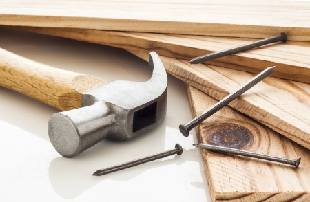 Wood planks with hammer and nails on white background Standard-Bild