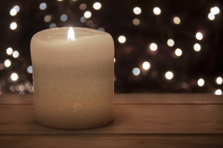 christmas spirit: old candle on a wooden table