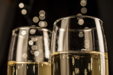 champagne glass: Flutes of champagne in holiday