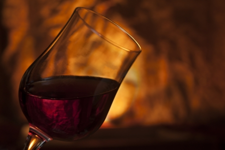 winy: Glass of red wine with bottle Stock Photo