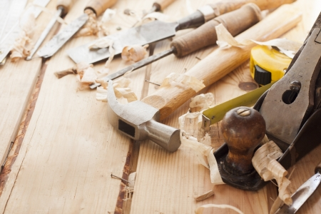 chisel: carpenter tools,hammer,meter,chisel and shavings over wood table Stock Photo