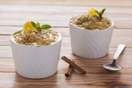 Creamy rice pudding sprinkled with cinnamon photo