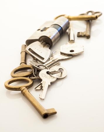 heap of keys isolated on white