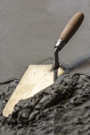 こてウェット コンクリート床の構築ツール 写真素材