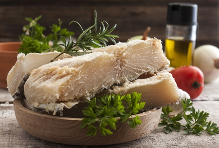 codfish: salted codfish on the wooden table with ingredients