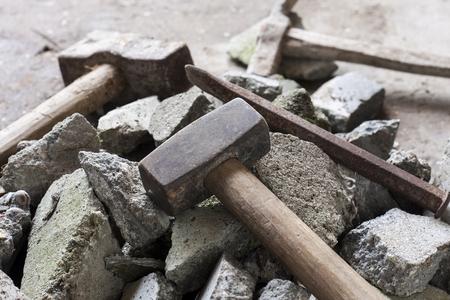 demolition: Concrete rubble debris with hammer