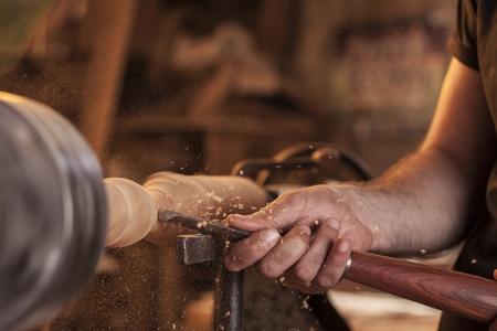 craftsmanship: worker turning wood on a lathe Stock Photo
