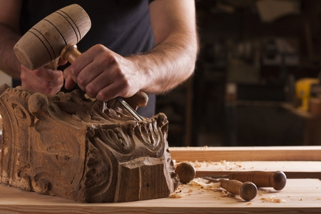 craftsman carving wood Stock Photo