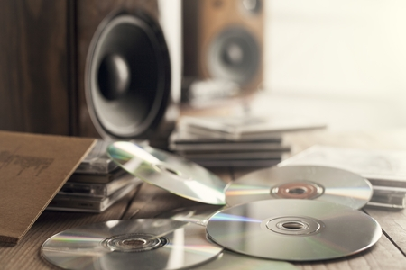 compact: Rows of music cds with speakers