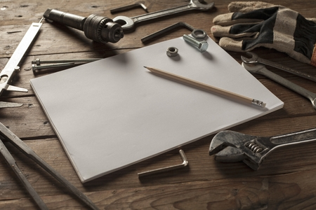 wor: Tools on the wood background with Blank sketchbook mockup