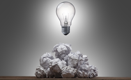 creative writer: Light Bulb On Pile of Crumpled Paper-Problem Solving Concept
