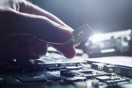 plug in: Plug in CPU microprocessor to motherboard socket. Technological concept