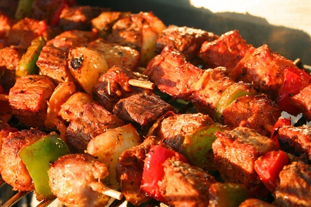 Detail of cooking Meat Brochettes on a Barbecue photo