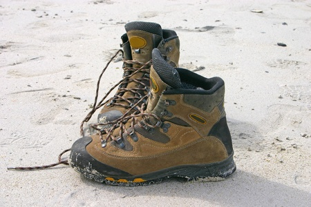 Pair of mountain shoes on the beach photo