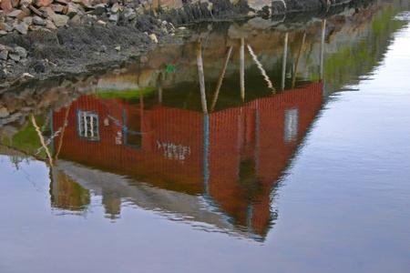 rorbu: Reflection of a rorbu in the water (Lofoten - Norway)