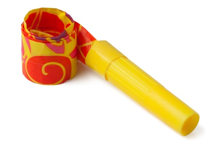 Yellow whistle to make noise on carnival parties on isolated background Stock Photo - 8947392