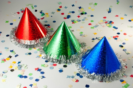 Red Blue and Green hats on confetti background Stock Photo - 9162064
