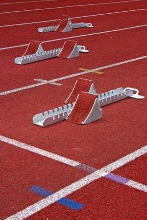 Athletics Starting Blocks and red running tracks in a stadion Stock Photo - 9865542