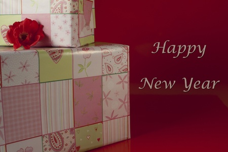 Presents wrapped in green and pink gift paper with hearts photo