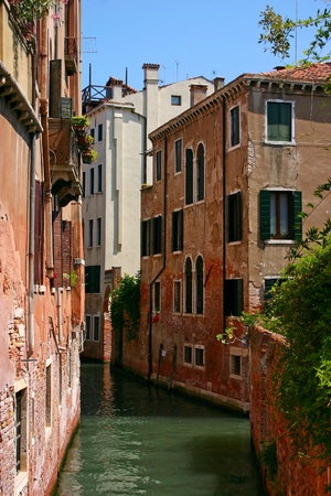 Small canal in the beautiful and romantic Venice photo