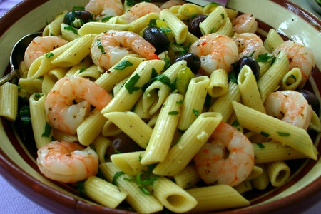 Fresh penne pasta with scampi, oregano and pepper Stock Photo - 12760391