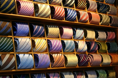 coat and tie: Fashionable Ties on a shelf in a shop