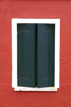 Window of one of the colored houses in Burano - Venice - Italy photo