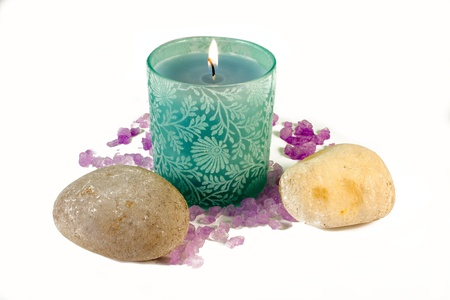 Green candle with purple aromatic sea salt photo