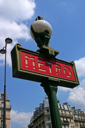 Ancient Metro Sign at the entrance of the Paris Metro photo