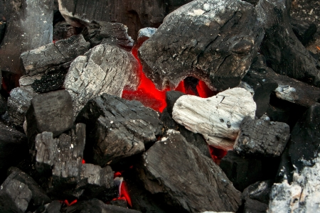 Close up of burning coals on a barbecue Standard-Bild